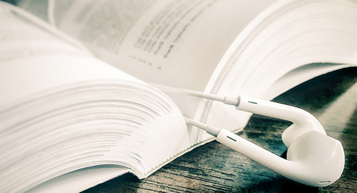 Book and Earbuds