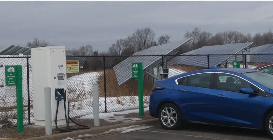 A Tesla at a charging station