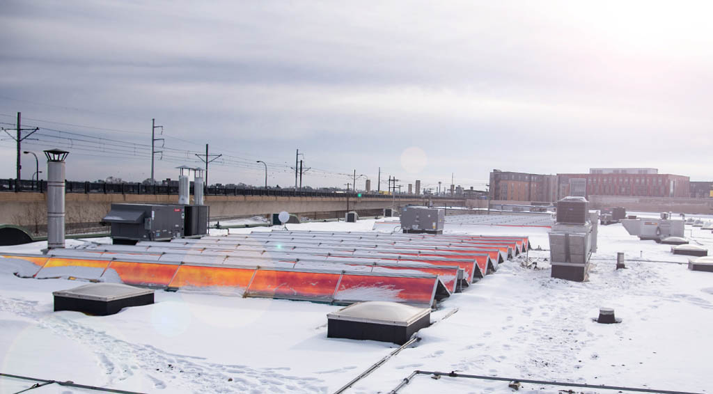 Solar panels on the roof of a Minneapolis building in winter