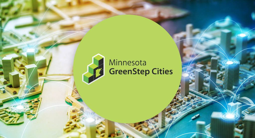 The GreenStep Cities logo over a rendering of a city