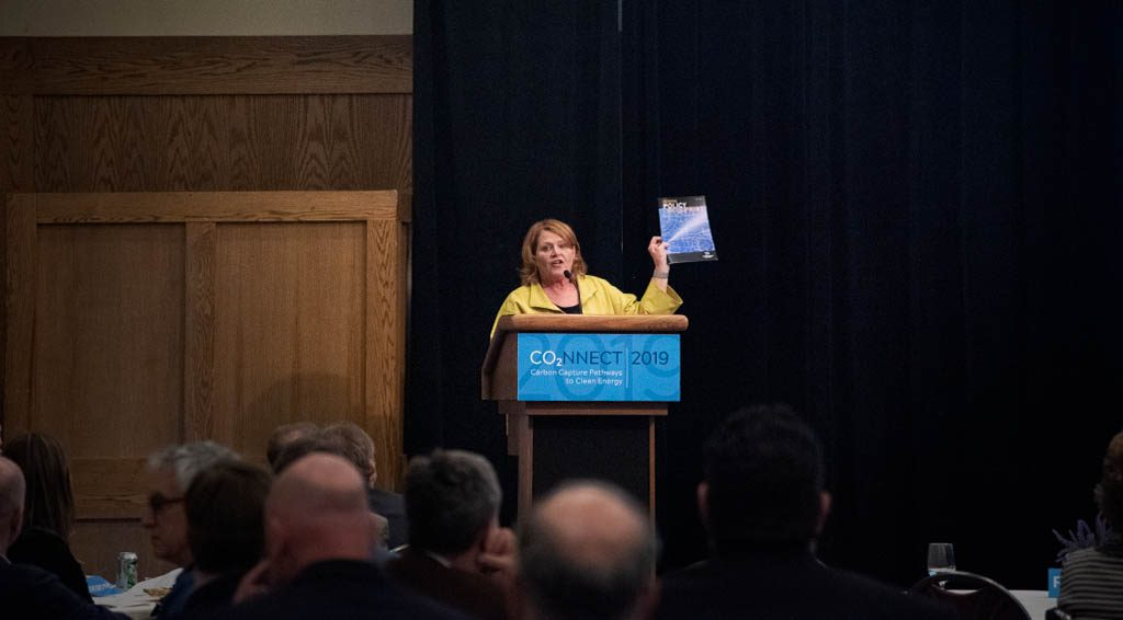 Heidi Heitkamp holding the Carbon Capture Blueprint