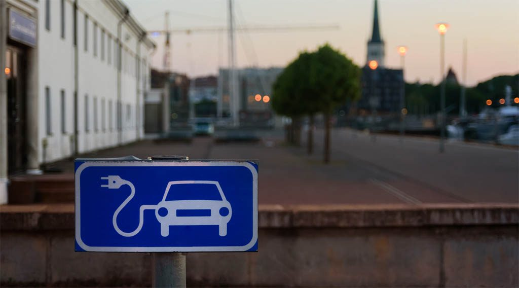 A sign demarcating electric vehicle charging