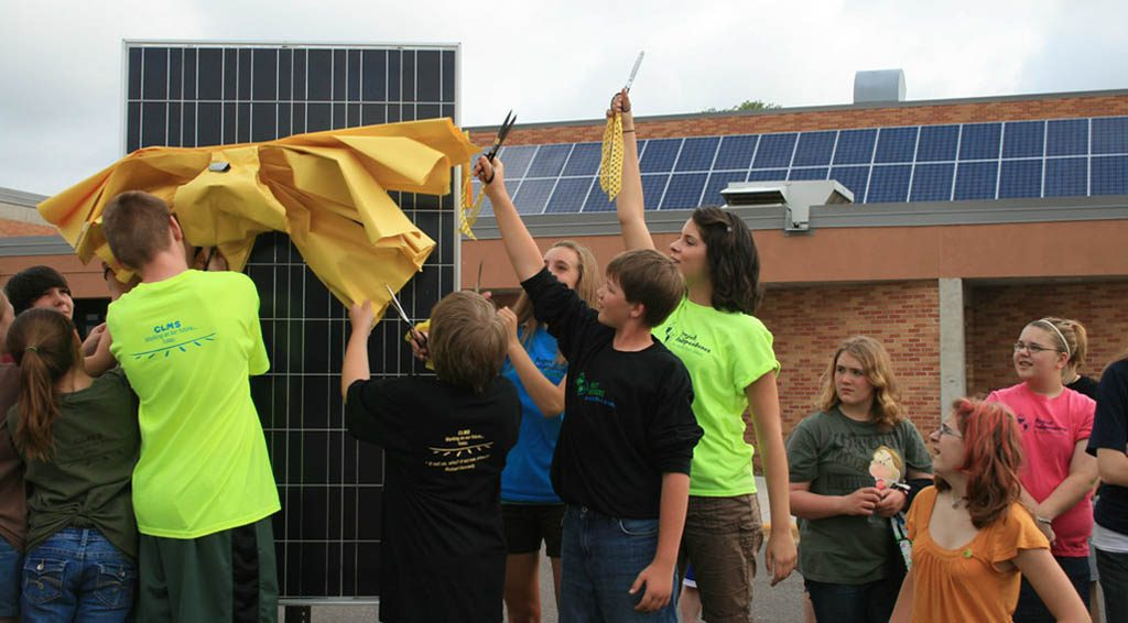 Children unveiling a new solar panel